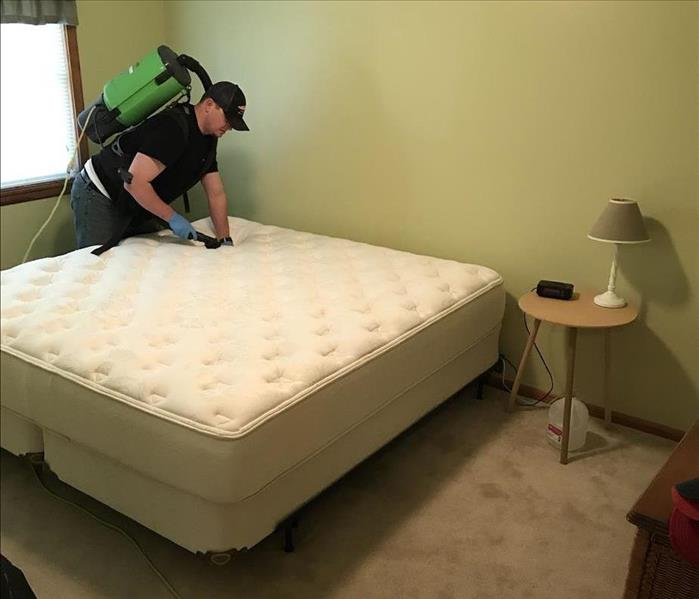 Vacuuming a mattress