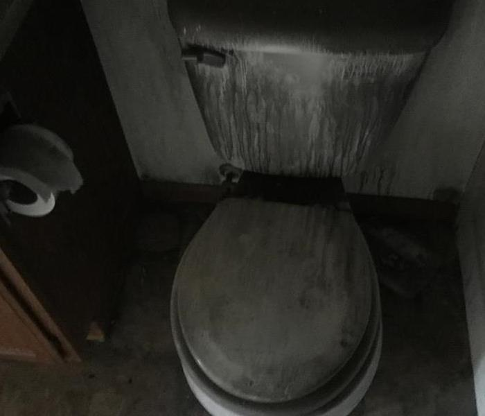Toilet covered in black soot in a Fergus Falls home.