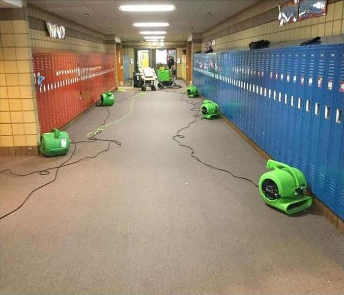 air movers placed in the hallways of a school